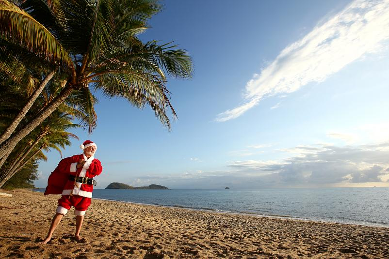 Christmas in paradise.Santa chills out at one of Queensland, Australia's tropical beaches before the big night. Queensland's beaches rank amongst the best in the world and Christmas in Queensland is about sun and summer. You'll find the warmest, whitest, biggest and most beautiful beaches stretched along the 7,400km coastline of Queensland, Australia.