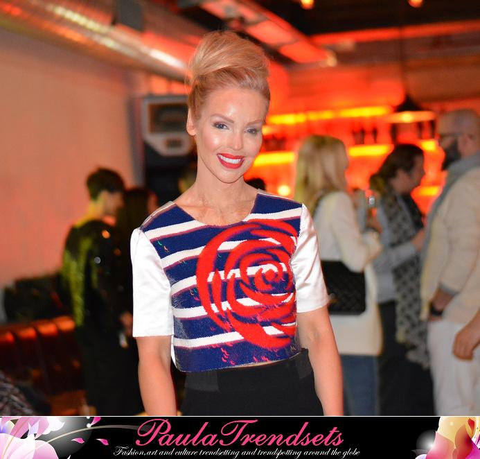 KSweet and radiant; katie Piper watched the show from the front row, wearing a top from Kolchagov Barba's Spring Summer 2015 collection.