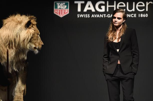 Cara Delevigne catwalking with a lion